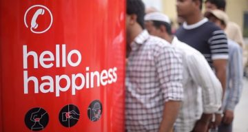 Coke Creates Phone Booth That Accepts Bottle Caps Instead Of Coins For UAE Workers To Call Home