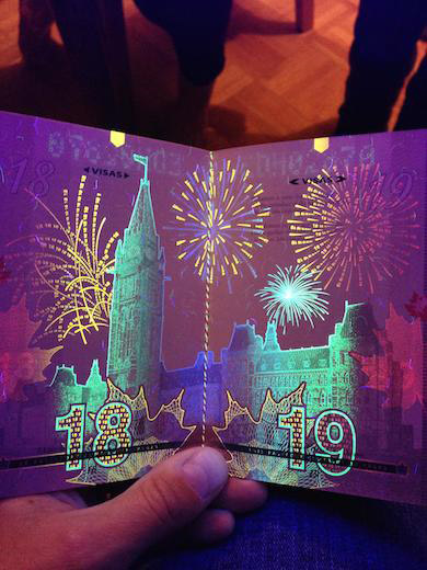 New Canadian Passport Under A Black Light - 1