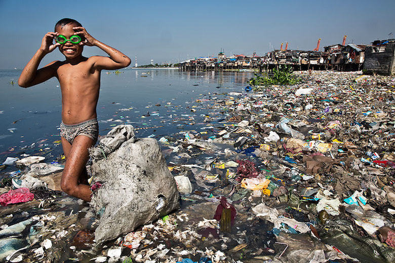 This boy spends each morning looking for recyclable plastic that he can sell for 35 cents/kilo to support his family