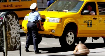 NYC Driver Refused To Move His Taxi, So This Tiny Traffic Cop Lifted It Off The Ground