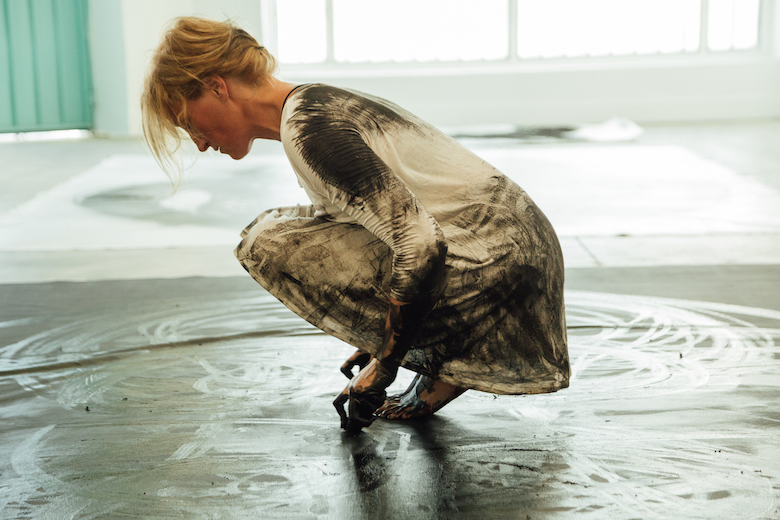 dancer draws beautiful abstract paintings using choreographed body movements